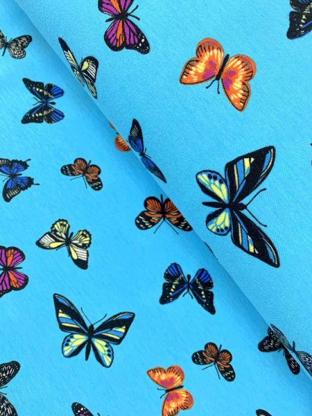 Baumwolljersey Ökotex Schmetterling Türkis